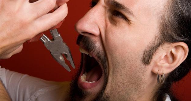Cara Alami Mengobati Sakit Gigi Berlubang