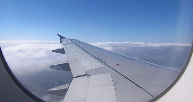 7 Tips Dapatkan Foto Keren di Pesawat